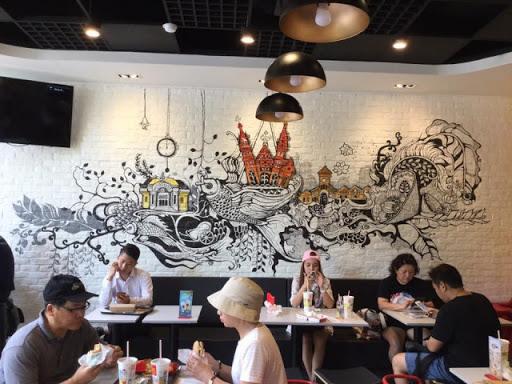 Vẽ tranh tường quán trà sữa đẹp mê hồn, thu hút khách hàng